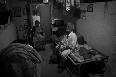 "Velayuthan pillai (Age 69), a tailor. Elephantiasis turned his life into misery by taking away both his legs. Having lost his legs and job, he returned back to his home town and joined as a guard for a temple for the pay of (Rupess 800) 17.60$ per month. With the help of this little income he's struggling to make both ends in life along with his wife."" Photo by Rajvinoth Jothineelakandan."